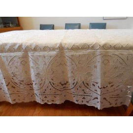 white cut and crochet tablecloth